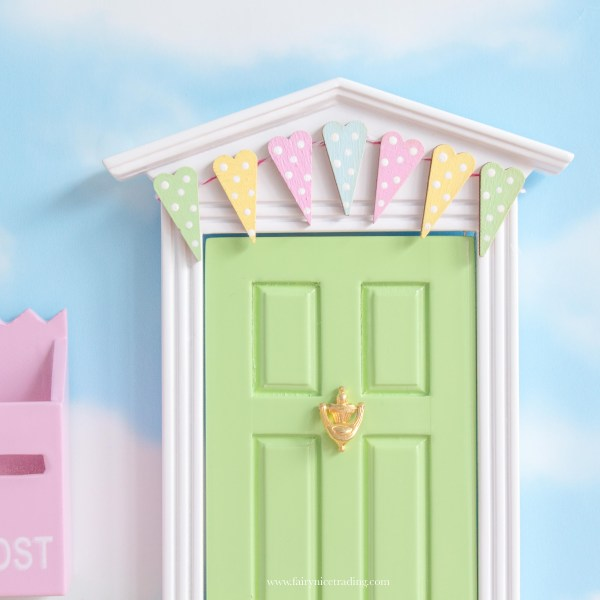 green fairy door with bunting uk