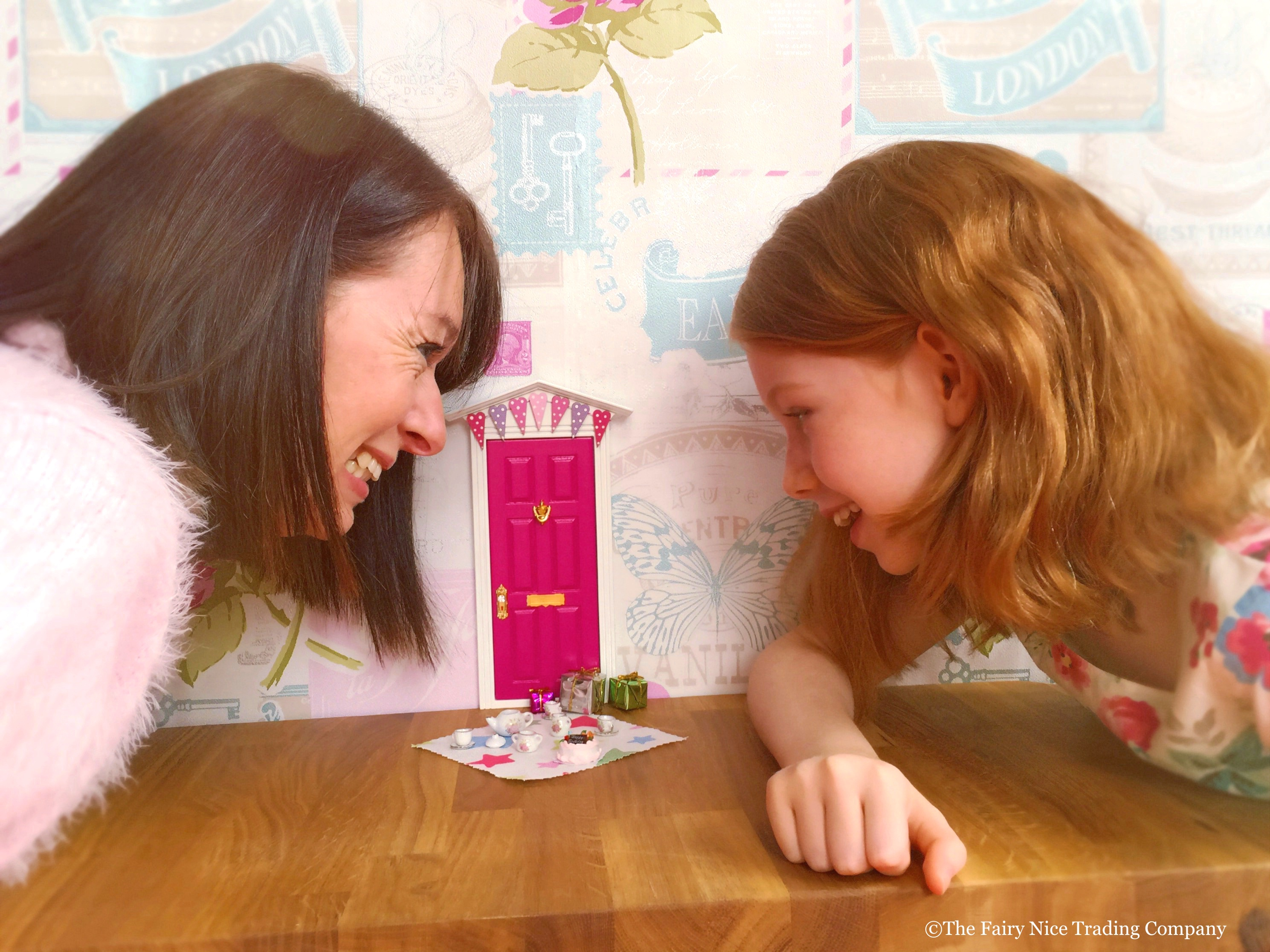 Mother and daughter discovering a beautiful Fairy Door