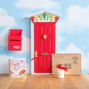 Magical red Fairy Door with bunting, UK