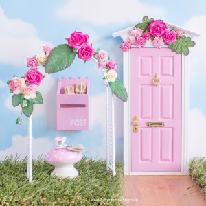summer pink fairy door with flower wall