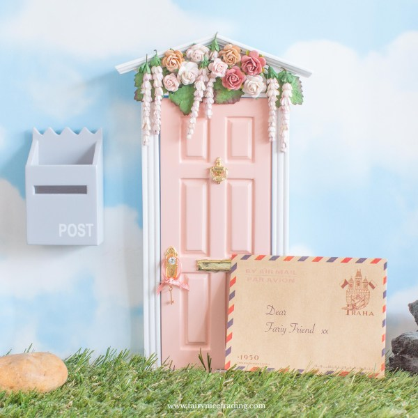 blush pink fairy door with flowers