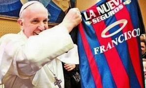 Pope Francis, long-time sports fan, displaying the jersey of his beloved San Lorenzo team.