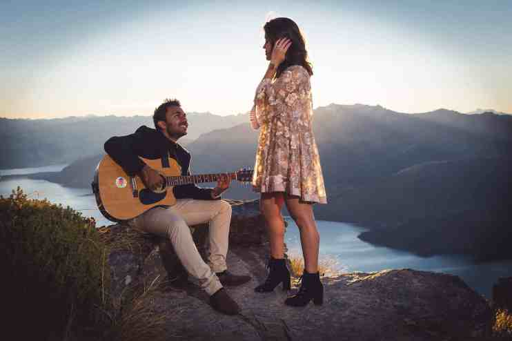 Roahan serenades Sujata at The Ledge, Cecil Peak shortly after proposing to her (she said yes).  The Ledge is one of my favourite Queenstown Proposal Locations