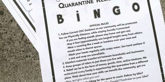 QRT Bingo Card displayed on pavement, printed on white paper in black ink.