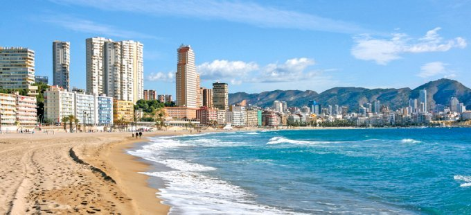 Benidorm - city of skyscrapers on Mediterranean beach. Spain in November.