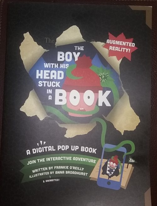 Boy with his head stuck in a book Zappar book review Family Clan