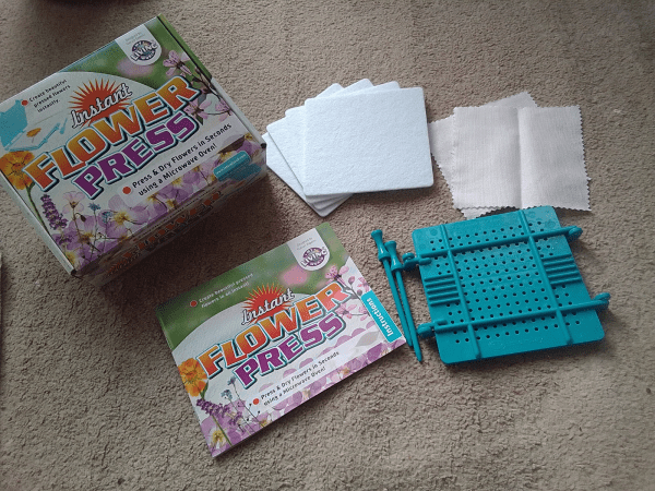 Instant Flower Press by Interplay review by Family Clan
