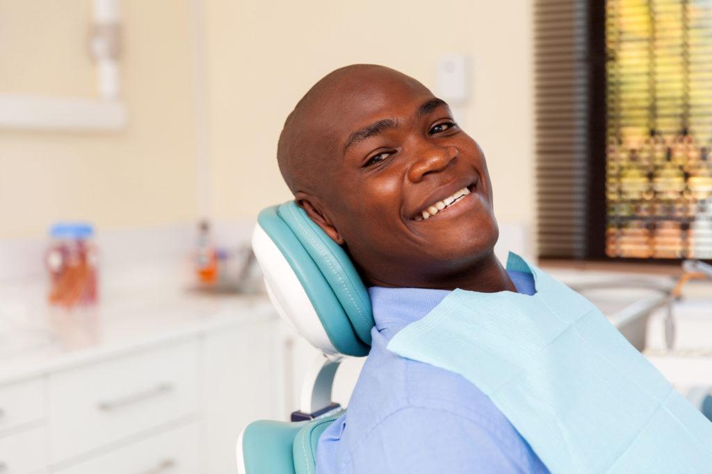 african man visiting dentist for dental checkup