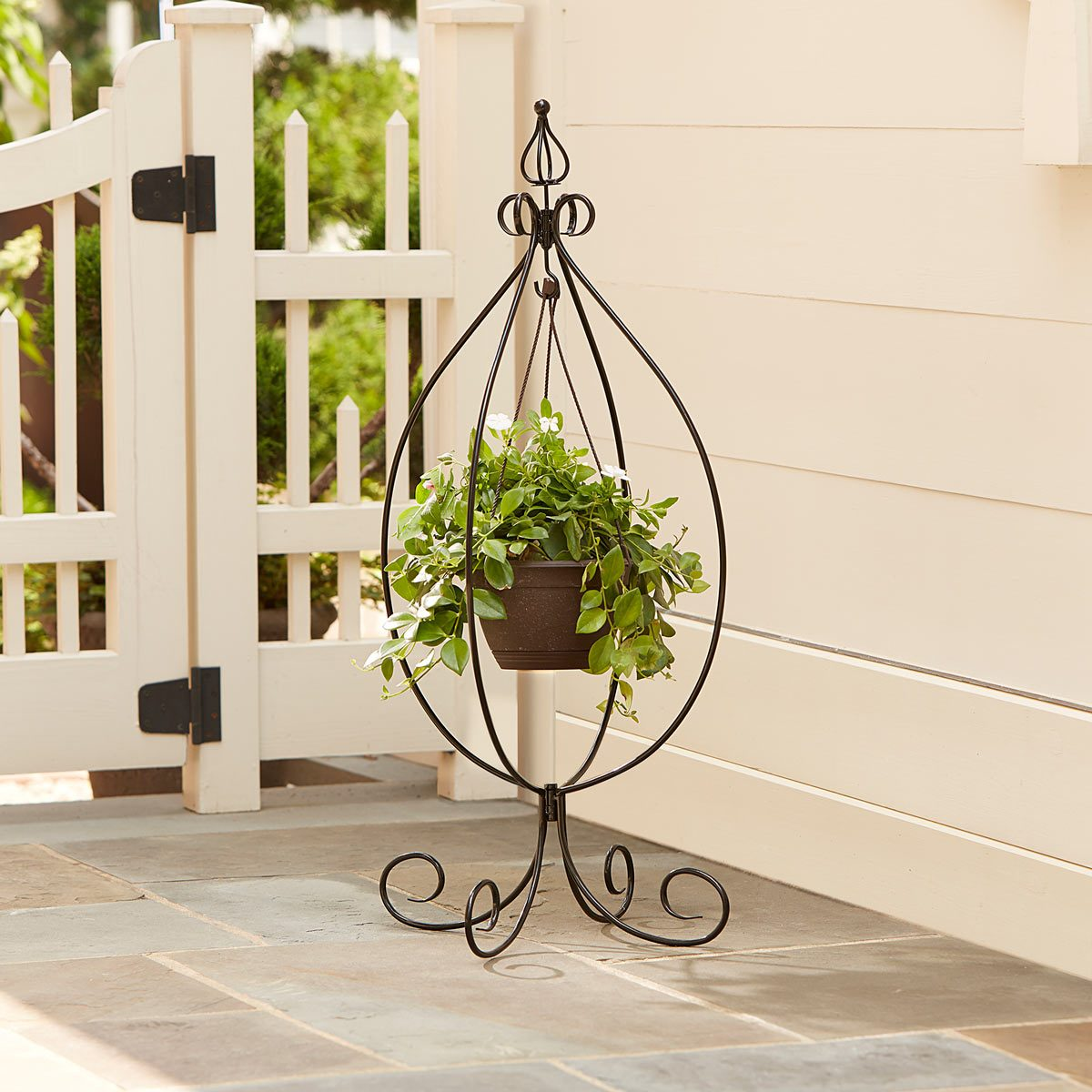 15 Creative Ways to Hang a Plant Outdoors — The Family ... on Stand For Hanging Plants  id=89605
