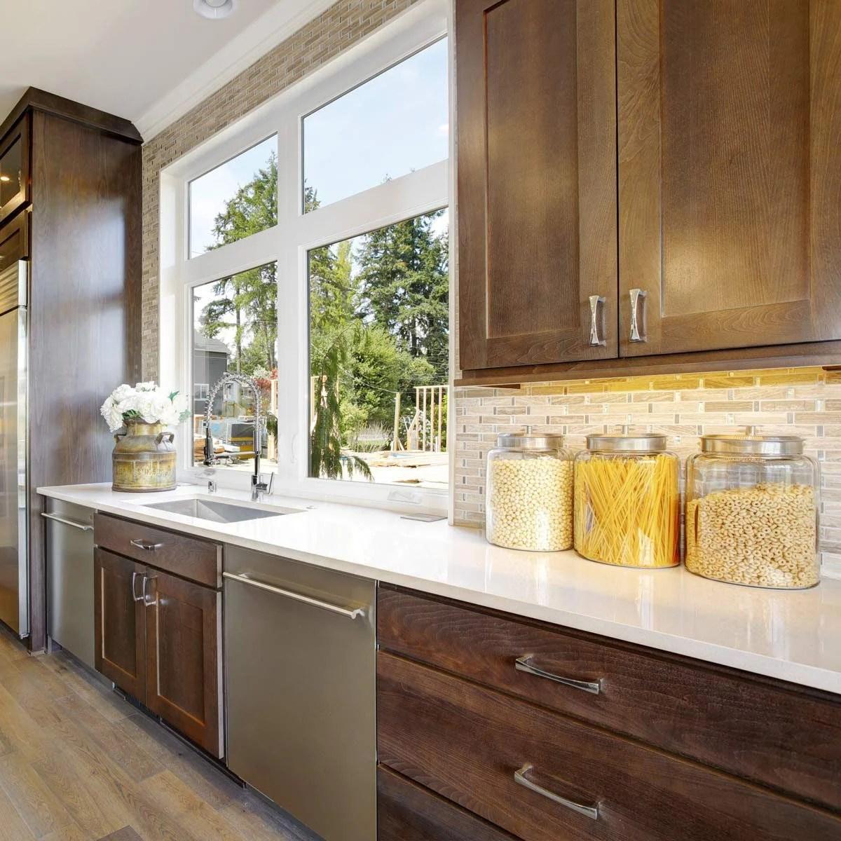 Best Kitchen Backsplash Ideas For Dark Cabinets | Family ... on Backsplash Ideas For Dark Cabinets And Light Countertops  id=75581