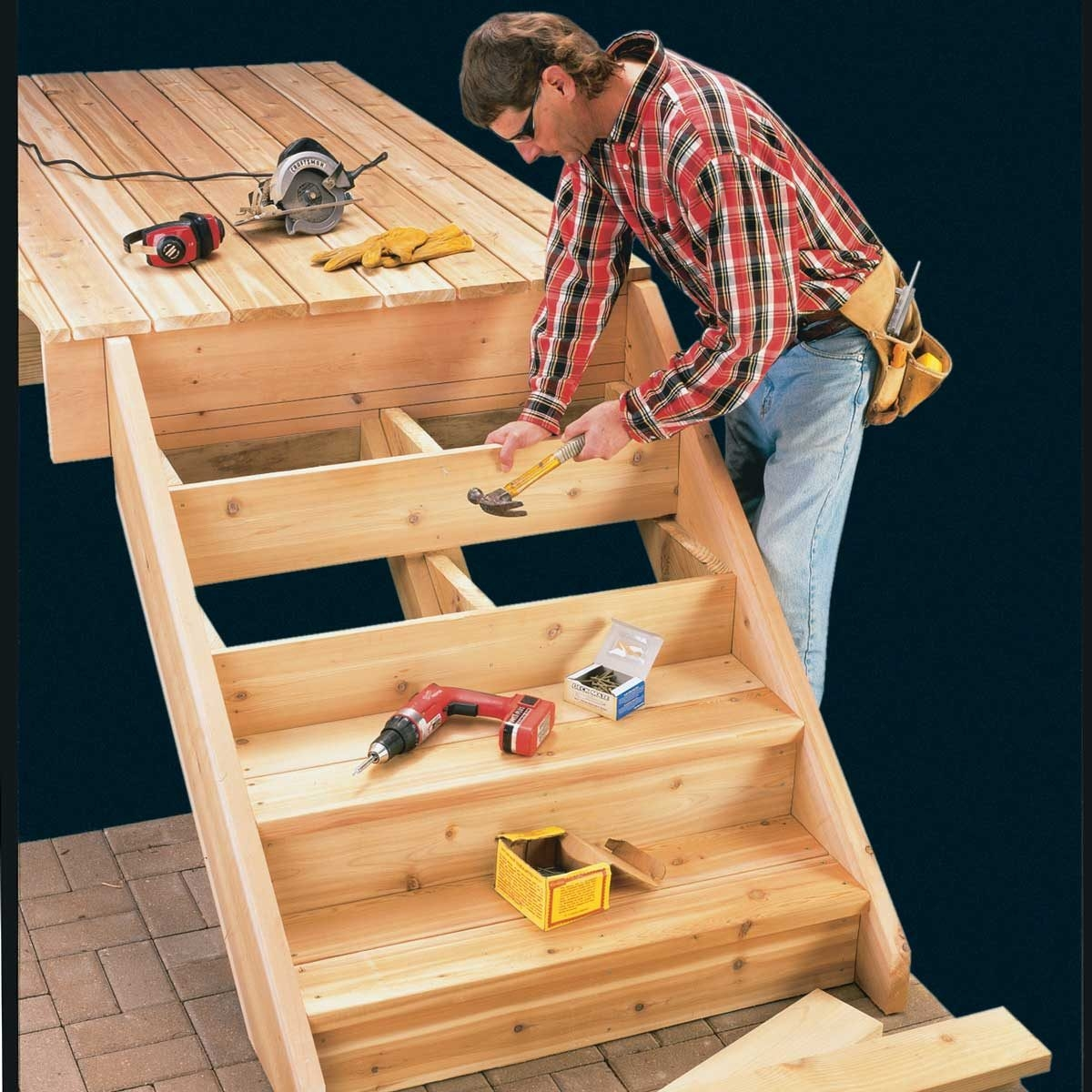 How To Build Deck Stairs The Family Handyman   Building Outdoor Steps With Wood   Pea Gravel   Stair Railing   Porch Steps   Composite Decking   Hillside