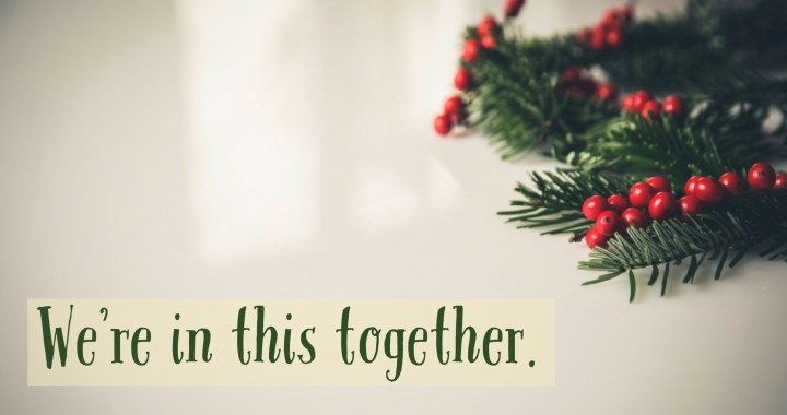 Christmas greenery with phrase: We're in this together