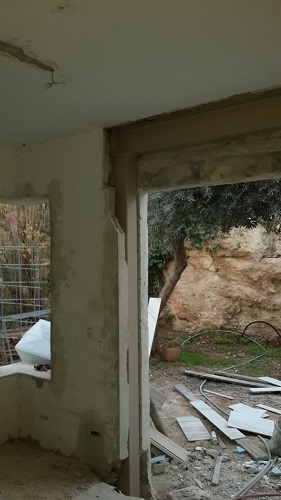 The hole for the new French doors