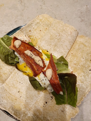 Smoked trout and runny egg gluten free wrap