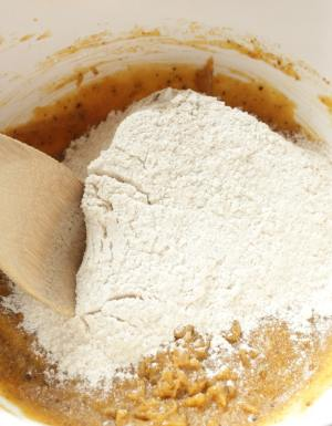 Mixing bowl with dry ingredients being added to the wet ingredients