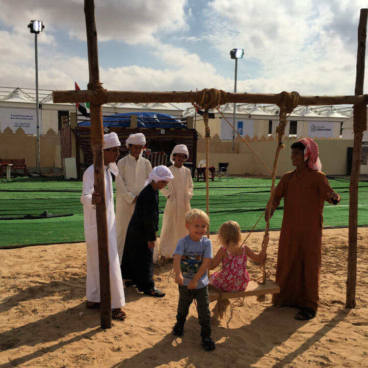 What health and safety? Trying the swings at the Childrens Village Al Dhafra Festival