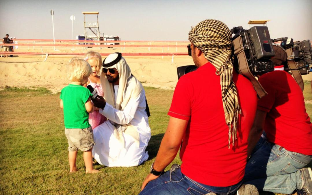 Western children being interviewed for local news at the Al Dharfa Festival in Abu Dhabi