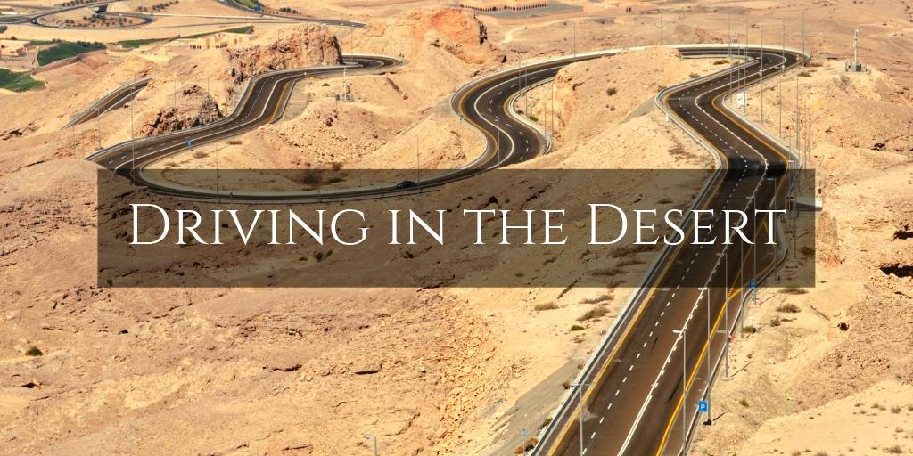 Long winding desert road up Jebel Hafeet - Desert Driving tips