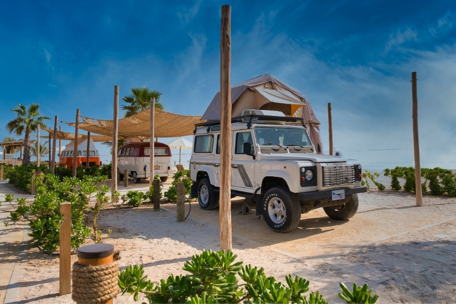Camper vans on the beach Bab al Nojoum Al Hudayriayat Island Abu Dhabi