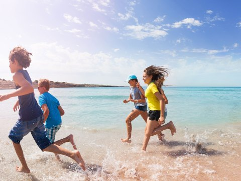Teens and Tweens Running on Beach; Courtesy of Sergey Novikov/Shutterstock.com