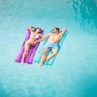 Couple In Pool; Courtesy of wavebreakmedia/Shutterstock.com