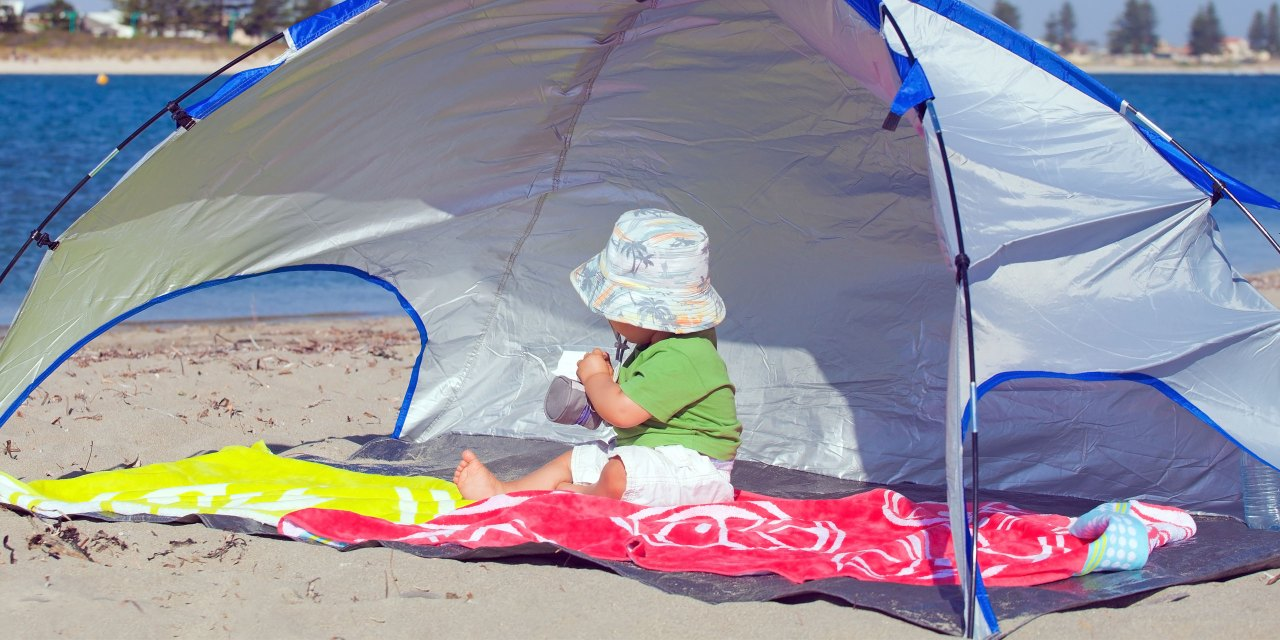 Baby In Beach Tent; Courtesy of Marcella Miriello/Shutterstock.com