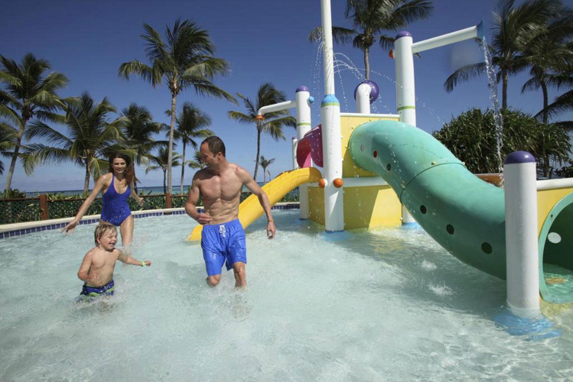 Parents and child at the water park at Club Med Punta Cana