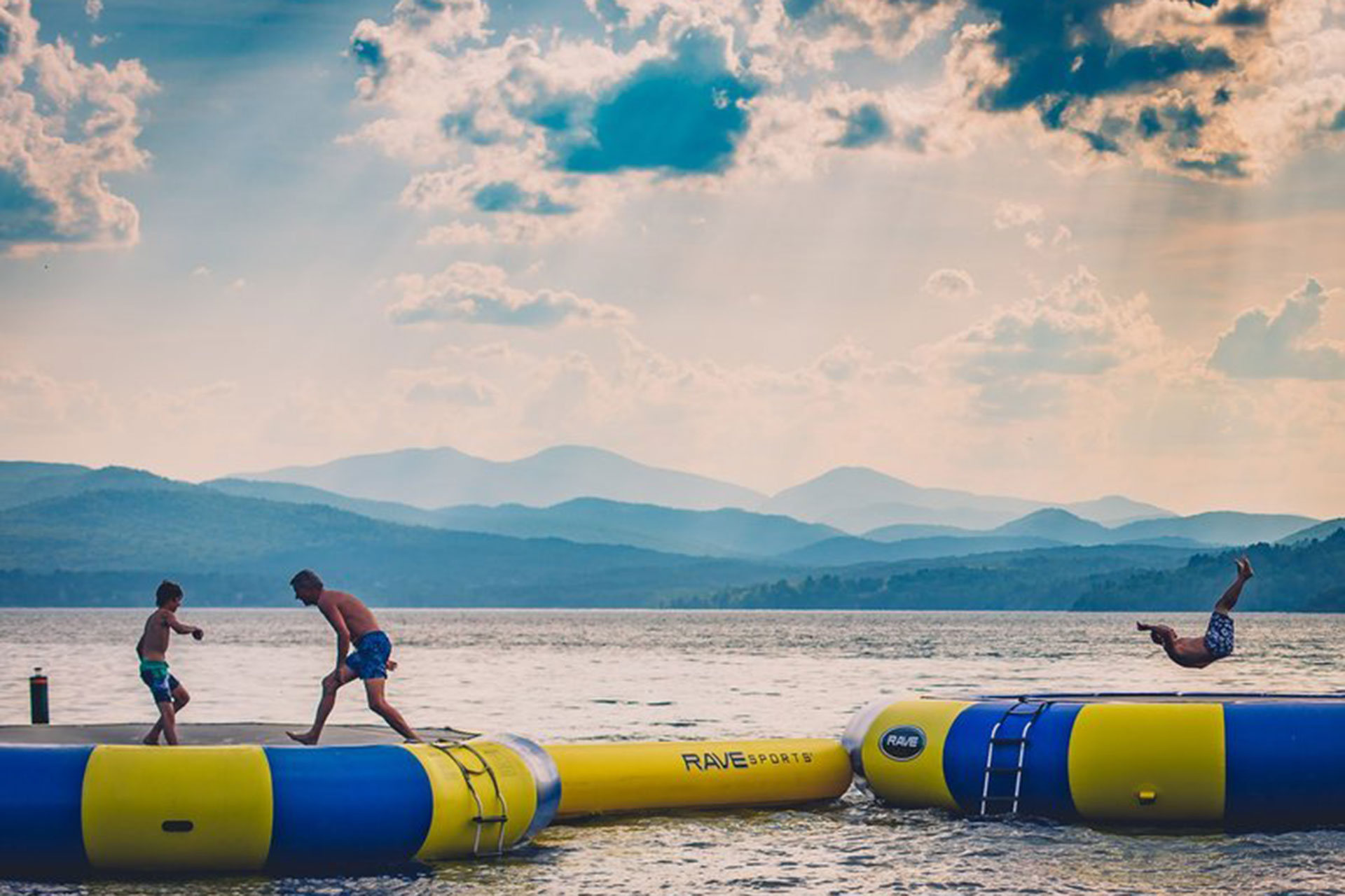Kids Playing on Water Trampolines at Basin Harbor Resort in Vermont; Courtesy of Basin Harbor