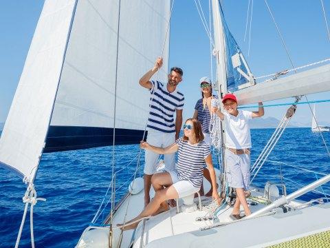 Family on Boat; Courtesy of Max Topchi/Shutterstock.com