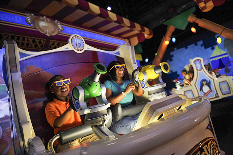 "Guests enjoy the new ""Toy Story Midway Mania!"" attraction at Disney's Hollywood Studios in Lake Buena Vista, Fla.; Courtesy of Walt Disney World"