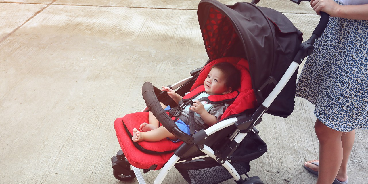 mom in a red stroller; Courtesy of Shutterstock