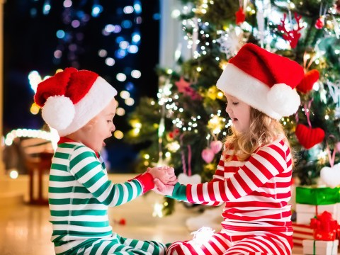 Happy little kids in matching red and green striped pajamas; Courtesy of Famveld/Shutterstock