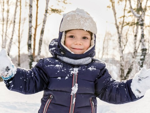 toddler boy plays in snow with mittens; Courtesy of Vikafoto33/Shutterstock