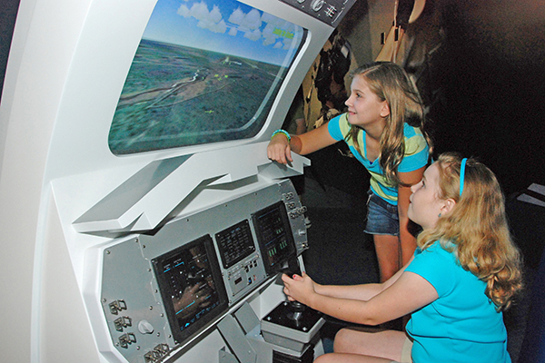 Two girls check out an exhibit at the Kennedy Space Center Visitor Complex