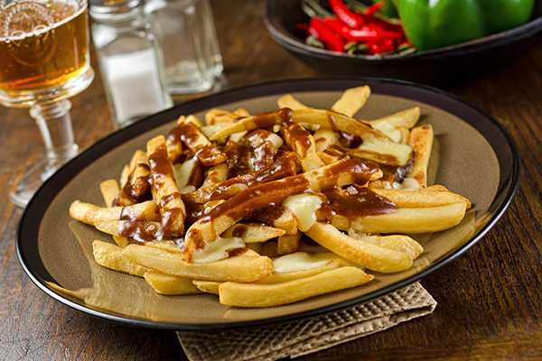Poutine is one of Canada's most famous foods, with French fries, cheese curds, and gravy.