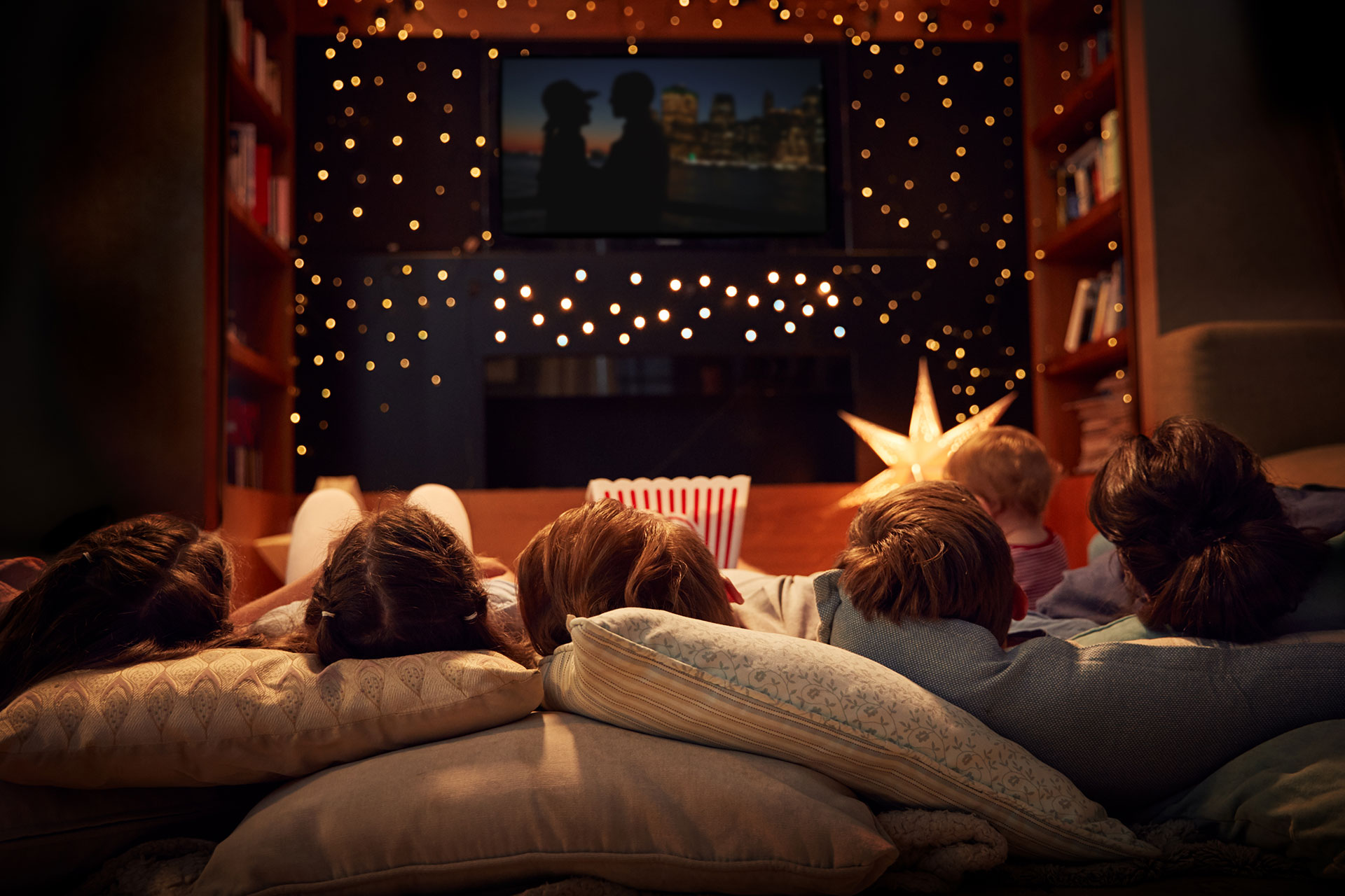 A family enjoying a movie night at home.