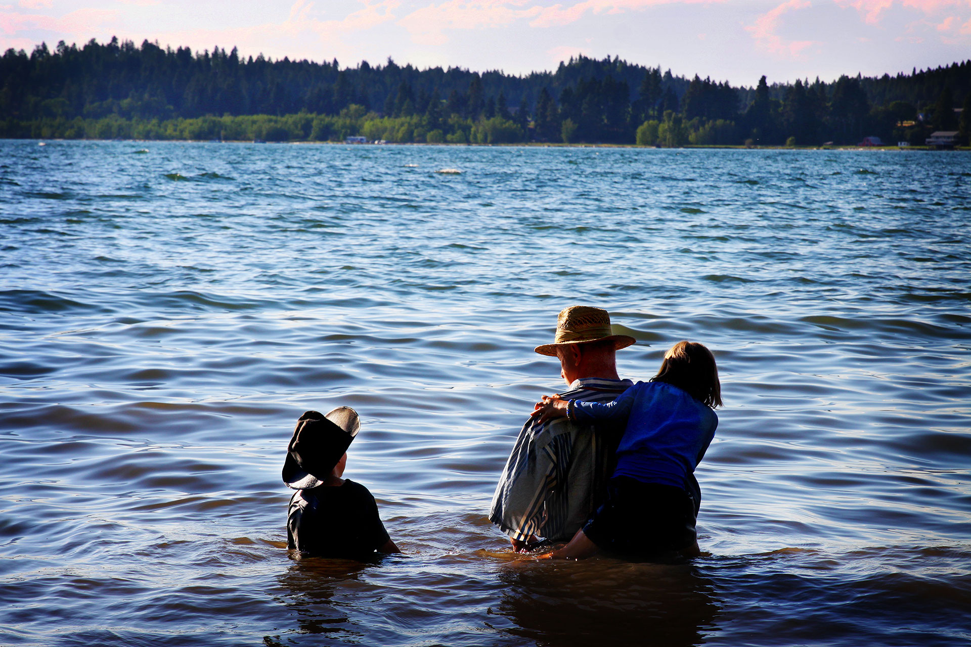 Father and Children Wading in Flathead Lake, MT
