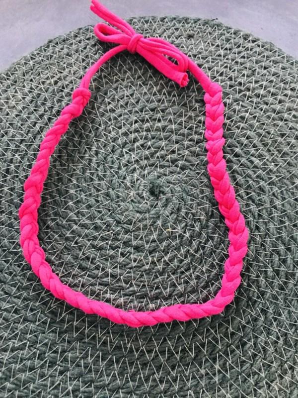 Roze gevlochten haarband