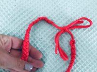 Gevlochten haarband zalmroze