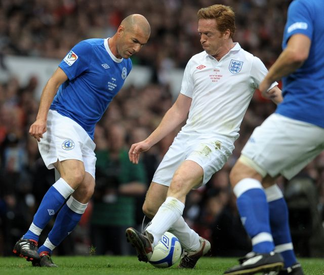 France's Zinedine Zidane (L) vies with British actor Damian Lewis during the Unicef Soccer Aid charity football match against the Rest of the world at Old Trafford in Manchester, north-west England on June 6, 2010. Soccer Aid is the brainchild of Robbie Williams and all money raised through profits from ticket sales and donations made by viewers of ITVduring the match will go to UNICEF's invaluable work helping children around the world. AFP PHOTO/ ANDREW YATES