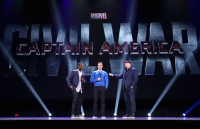 "ANAHEIM, CA - AUGUST 15:  (L-R) Actors Anthony Mackie, Chris Evans and Producer Kevin Feige of CAPTAIN AMERICA: CIVIL WAR took part today in ""Worlds, Galaxies, and Universes: Live Action at The Walt Disney Studios"" presentation at Disney's D23 EXPO 2015 in Anaheim, Calif.  (Photo by Jesse Grant/Getty Images for Disney) *** Local Caption *** Anthony Mackie; Chris Evans; Kevin Feige"