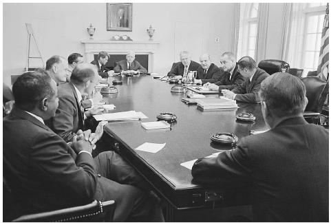President Lyndon Johnson (right side, second from right) shown meeting with the National Security Council in 1964 with the prime topic expected to be the North Vietnamese torpedo boat attack on the U.S. destroyer Maddox. ©BETTMANN/CORBIS.