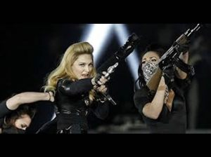 Madonna , Pepsi Center , Gang Bang , James Holmes , Batman