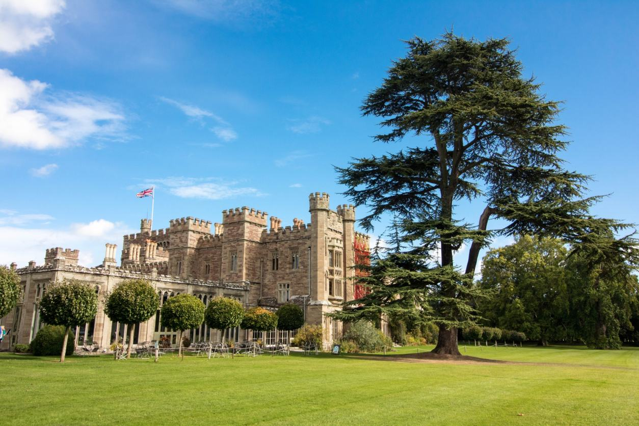 Hampton Court Castle and Gardens. Blue skies. Old British castle. Top 25 Things to Do in Herefordshire.