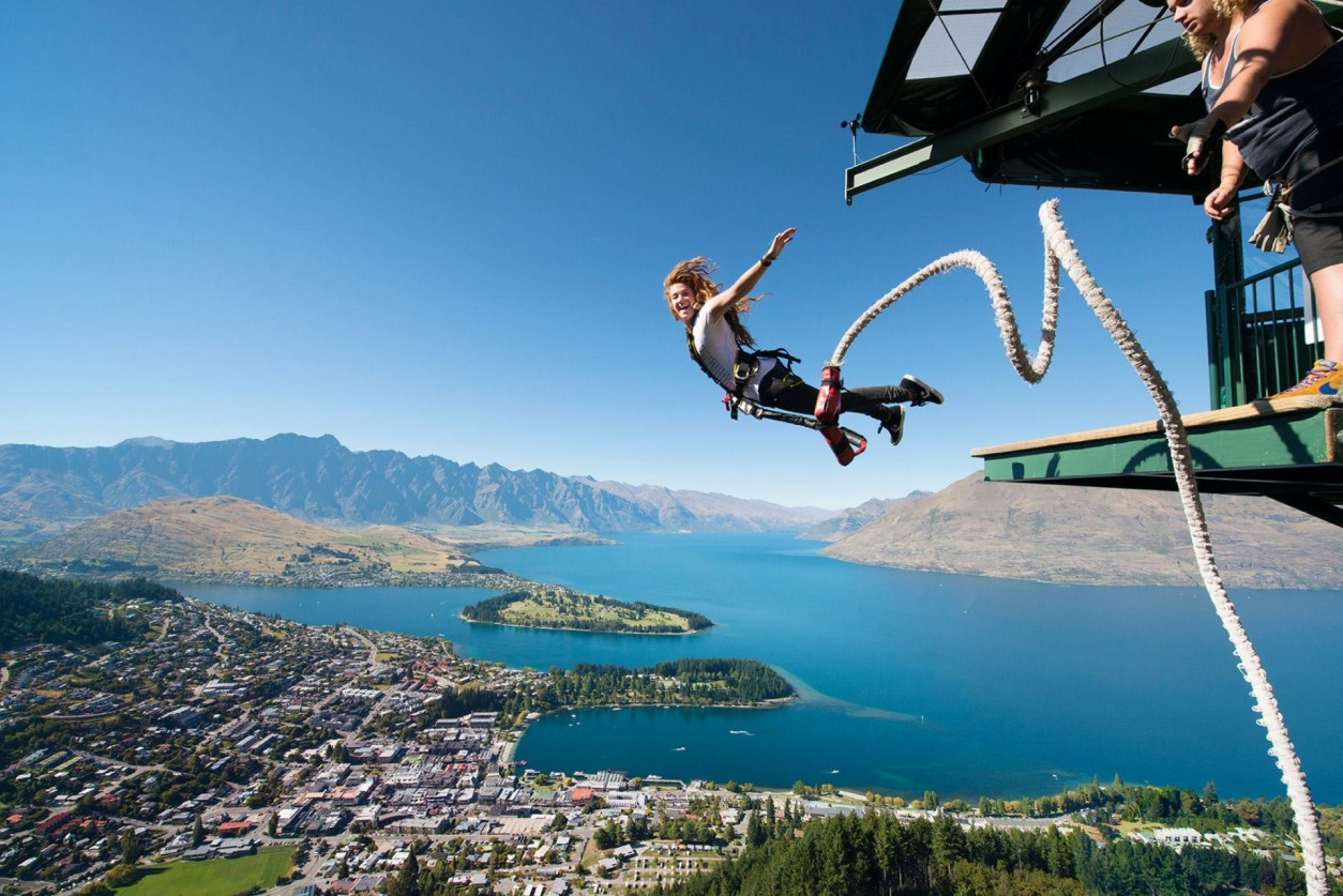 woman-smiling-and-screaming-as-she-jumps-off-ledge-bungee-jumping-at-queenstown-aj-hackett-ledge-bungee-jump-new-zealand-bucket-list