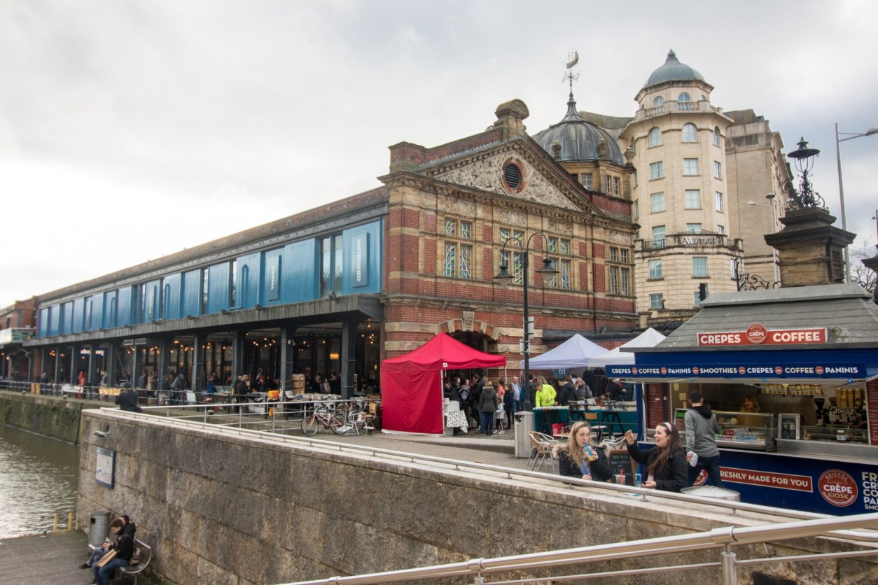 Bristol harbourside markets and food stalls and street food. Crepes coffee. People shopping and eating food by harbour. Watershed Bristol. How to Spend the Perfect Day on Bristol Harbourside. What to do on Bristol Harbourside. Bristol UK. Bristol England. Things to do on Bristol Harbourside. Bristol travel guide. Bristol travel tips. Bristol travel blog. What to do in Bristol. What to see in Bristol. Things to do in Bristol. Things to see in Bristol. How to spend a day in Bristol.