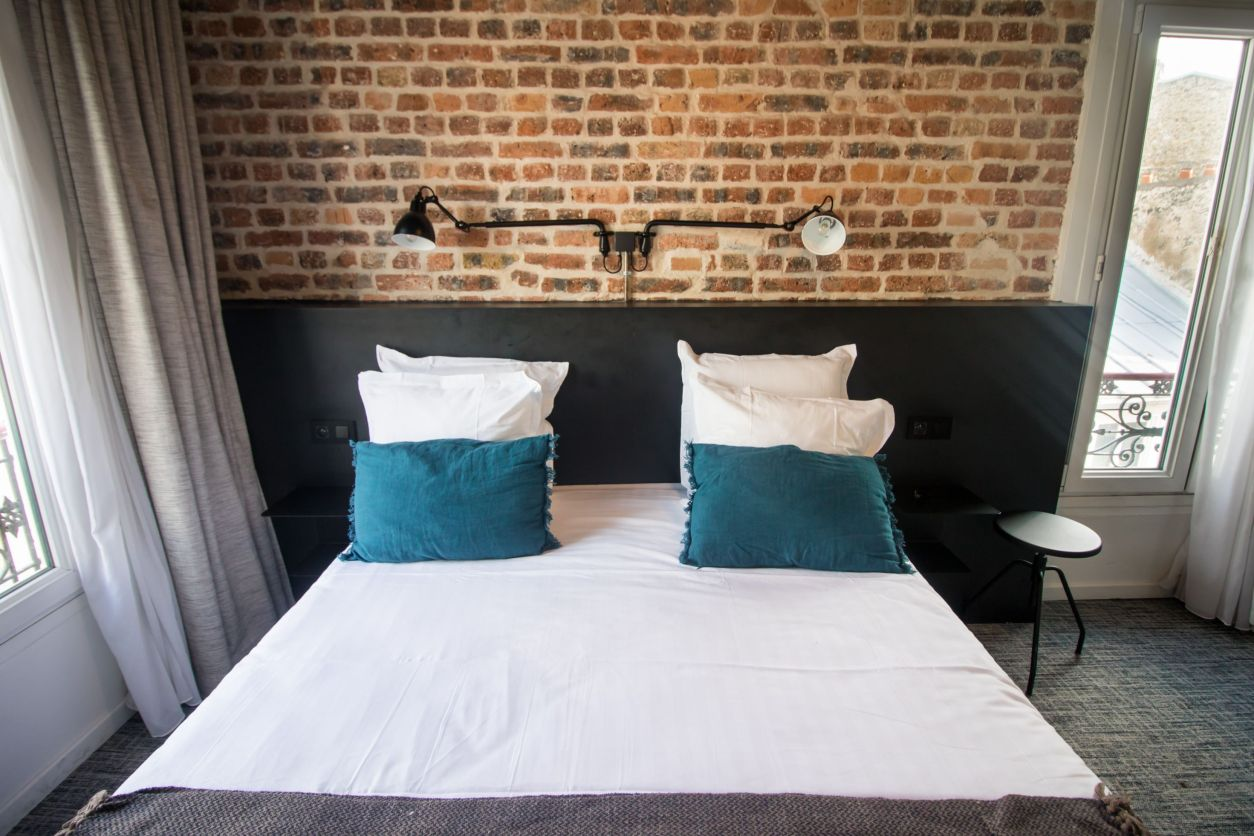 Cool, quirky, unique brick wall in hotel room with black minimalistic lights. Scandinavian style. Bed with white sheets and turquoise pillows. Hotel Baby Paris Review: The Best Budget Hotel in Paris. Paris hotel. Paris hotels. Paris France. Paris budget hotels. Best hotels in Paris. Paris accommodation. Cheap hotels in Paris. Paris hotel deals. Places to stay in Paris. Top hotels in Paris. Paris hotel booking. Where to stay in Paris. Cheap accommodation in Paris. Hotels in central Paris. Paris travel blog. Paris travel guide. Things to do in Paris. What to do in Paris. Places to See in Paris. Things to see in Paris. What to see in Paris. Click through to read more...