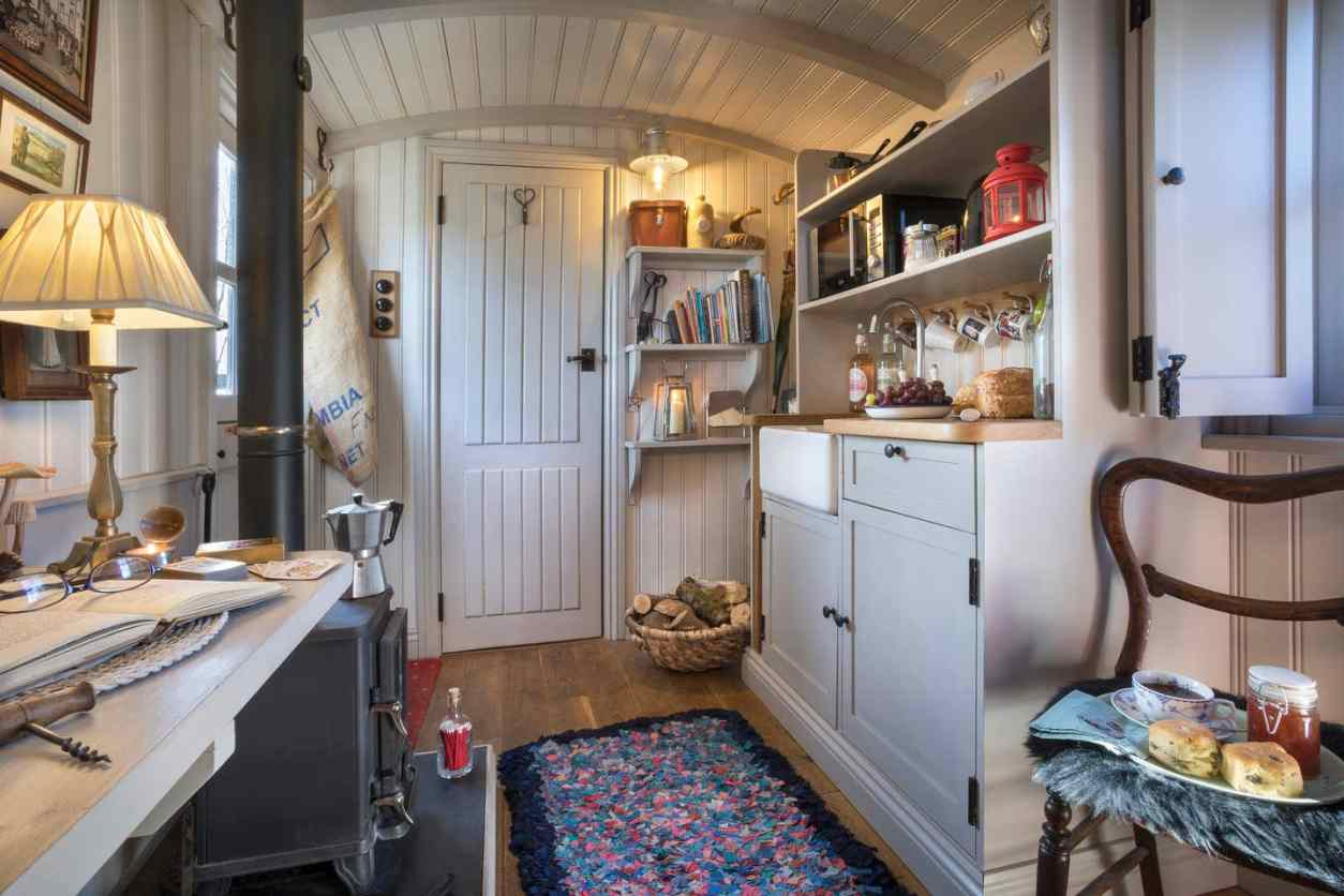 desk-wood-stove-and-kitchenette-in-shepherds-hut-lake-district