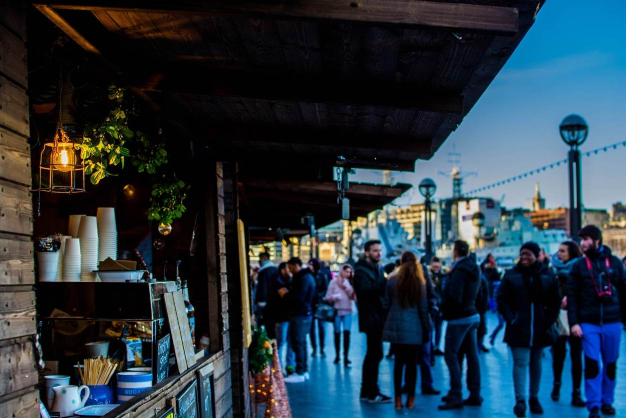 people-walking-around-christmas-market-stalls-southbank-bankside-things-to-do-in-london-at-christmas