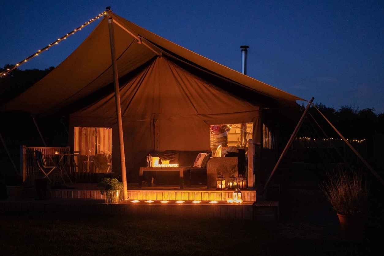 safari-tent-lit-up-at-night-seven-hills-hideaway-safari-tents-monmouthshire
